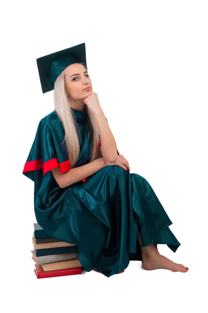 shoeless: University student in the mantle with books Stock Photo