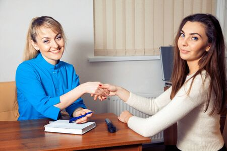 medicine and health concept. charming girl the doctor and the patient satisfied shake hands