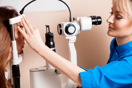 fundus: ophthalmologist checks eyesight at her patient. Ophthalmologist. medical, health, ophthalmology concept Stock Photo
