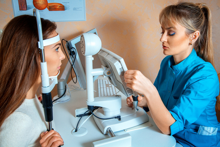 patient checks her vision by an ophthalmologist. Ophthalmologist. medical, health, ophthalmology concept Stock Photo