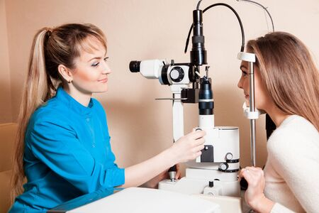 cute woman consulted an ophthalmologist about her vision. Ophthalmologist. medical, health, ophthalmology concept Stock Photo