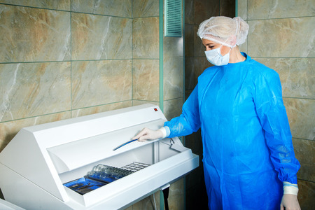 fundus: woman doctor gets sterile items required for operation. Ophthalmologist. medical, health, ophthalmology concept