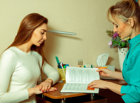 specialists: Woman patient consults specialists on sight. medicine and health concept