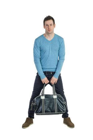 pullover: Young man in blue pullover and jeans holding leather bag Stock Photo
