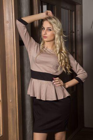 gir: Gir is posingl in a beige dress Stock Photo