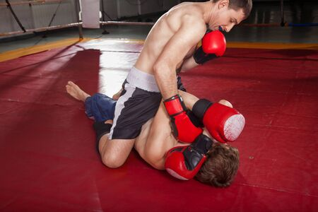 opponent: Boxer in black shorts is trying to knock his opponent out Stock Photo