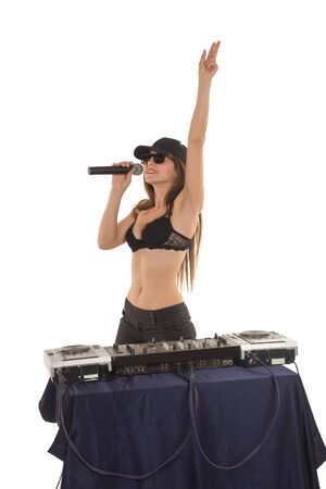 hand bra: Girl DJ in the black bra is singing with her hand up
