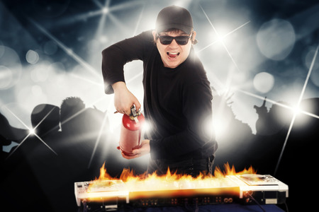 stopper: DJ with the fire stopper in night club Stock Photo
