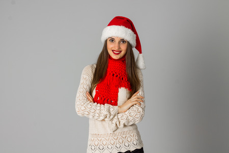 cutie: cutie girl in santa hat and red scarf in studio on gray background