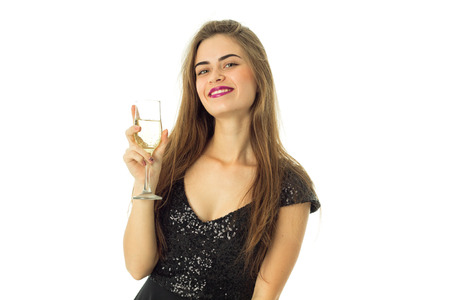 streight: Cheerful young lady with purple lips and glass of champagne looking at the camera and smiling isolated on white backgrund Stock Photo