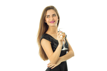 streight: young pretty cheerful woman with glass of champagne looking aside isolated on white background