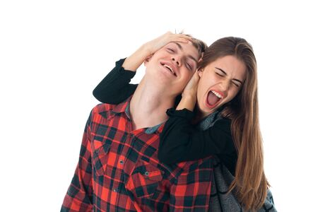 portrait of charming stylish couple in love having fun in studio isolated on white background