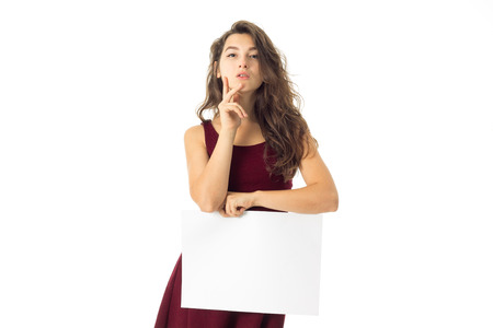 seductive young woman in red dress with white placard in hands isolated