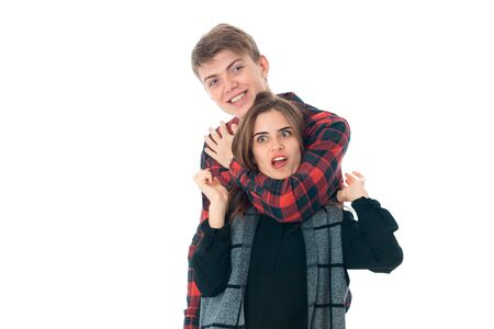close up of happy young stylish couple in love having fun in studio isolated on white background Stock Photo