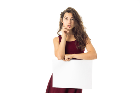 copyspace: gorgeous young woman in red dress with white placard in hands isolated