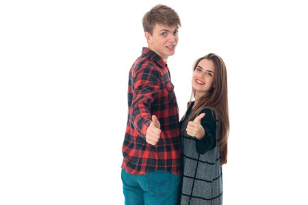 close up portrait of funny young stylish couple in love having fun in studio isolated on white background