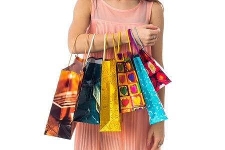 colorful shopping bags hang a girls hand closeup Stock Photo