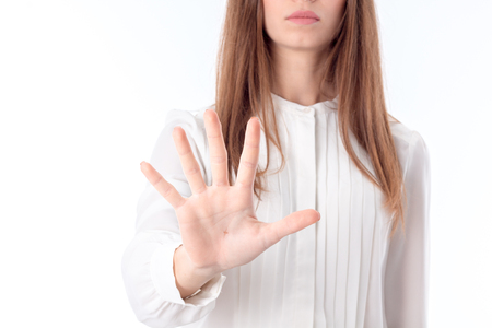 the girl in the white blouse stretched her hand forward and shows a hand with fingers spread closeup Stock Photo