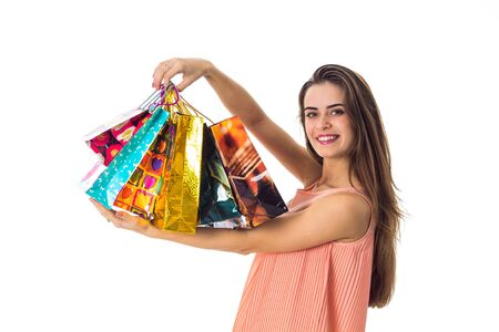 beautiful young girl smiles and shows a lot of different packages of stores close-up Stock Photo