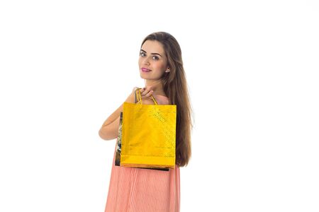 girl holds a large package of yellow front isolated on white background