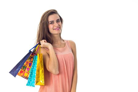 girl holds in one hand a lot of packages with purchases isolated on white background