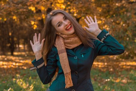 young girl with long hair in the Park and rage lifted her hands up Stock Photo