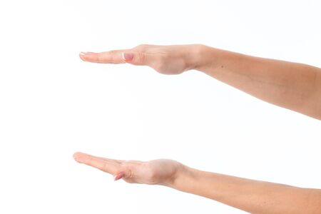 two female hands outstretched toward the one opposite the other isolated on white Stock Photo