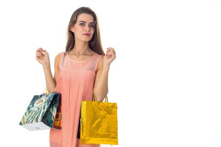 girl with shopping in the hands looks toward isolated on white background Stock Photo