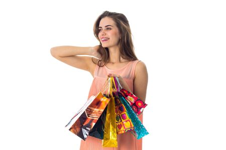 girl worth unscrewing my head to the side and holding a ranye packages isolated on white