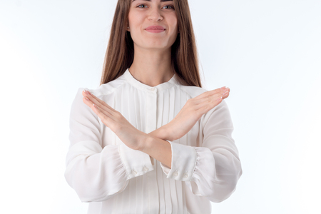young girl in white shirt makes cross hands Stock Photo