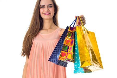 young girl stretches forward many big bright packages with gifts Stock Photo
