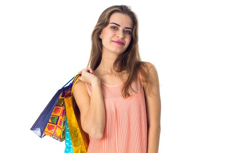 a young girl stands up straight and keeps the shoulder bags isolated on white Reklamní fotografie