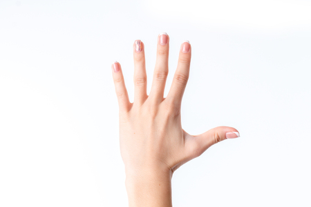 hand showing the gesture with five fingers is isolated on a white background