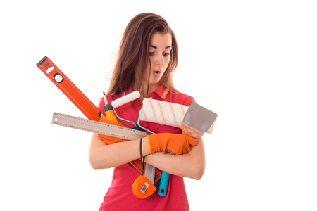 a young girl in a red t-shirt with the surprised face holding a measuring instruments isolated on white