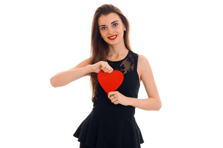 cutie brunette woman in love posing with red heart in her hands isolated on white