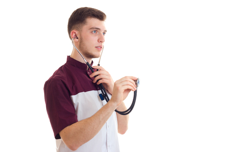 a young graduate doctor seriously keeps a stethoscope in hand isolated on white background