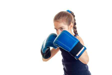 pugilist: little girl holding hands in the face of the big boxing gloves is isolated on a white background