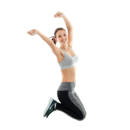 waistline: fun athletic young girl at the top and she jumps up and laughs is isolated on a white background