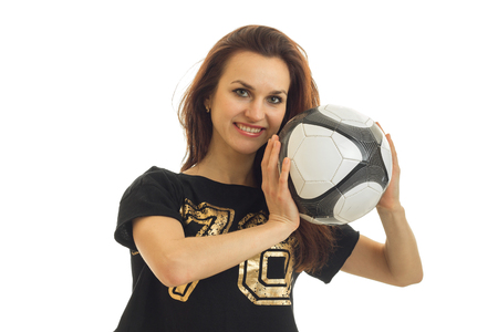 arbitrator: Portrait of a happy beautiful girl athletes who laughs and holds the ball near the face isolated on white background