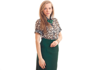 customer support: young sexy blonde stands in blouse and green skirt and looks into a camera isolated on white background Stock Photo
