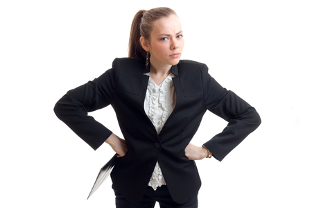 pretty disgruntled business blonde put hands on hips and looks into a camera isolated on white background Stock Photo