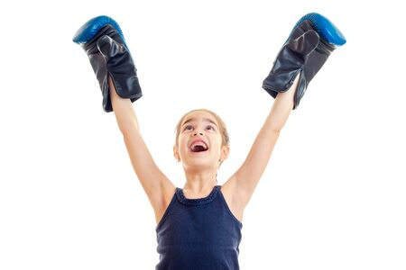 pugilist: little girl boxing winner screaming with hands up in the air isolated on white background