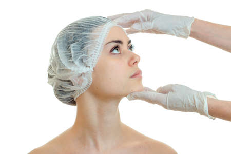 analyses: dermatologist in gloves for a girls face prepares analyses close-up isolated on white background