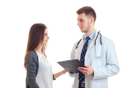 Schöne geduldige Blick auf eine primäre Obhut Arzt in der weißen Robe ist auf einem weißen Hintergrund isoliert close-up Standard-Bild - 79144394