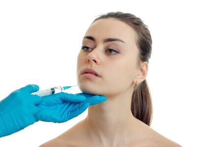 the woman at the plastic surgeon does prick isolated on white background Stock Photo