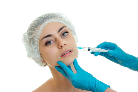 bodycare: woman Rejuvenates the face of plastic surgeon isolated on white background Stock Photo