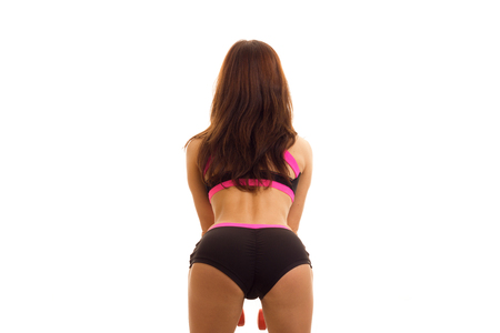 makes: beautiful girl makes the exercise from backside isolated on white background