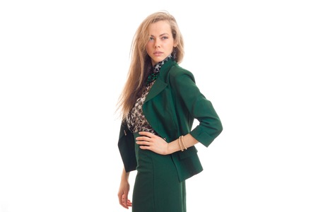 gorgeous young blonde business woman in green unifrom isolated on white background