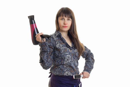 young woman holding a stylist hair dryer is isolated on a white background