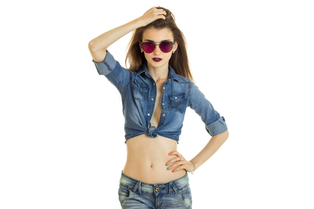 nude babe: Fashionablslim woman in jeans clothes and sunglasses isolated on white background